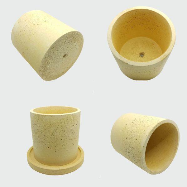Maceta de cemento cilíndrica color amarillo