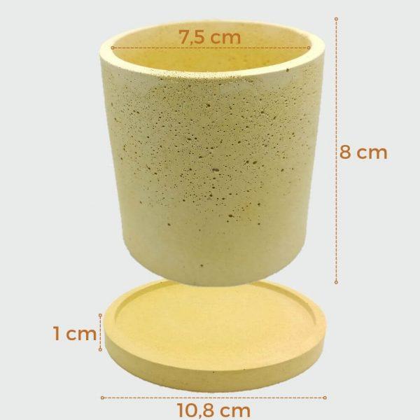 Maceta de cemento cilíndrica de color amarillo